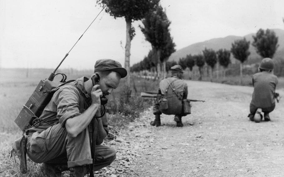 The U.S. Army Signal Corps has been a leader in the development of new and better methods of communication on the battlefield. In this photo from 1952, a soldier checks with artillery headquarters via 'walkie,' s Signal Corps development.