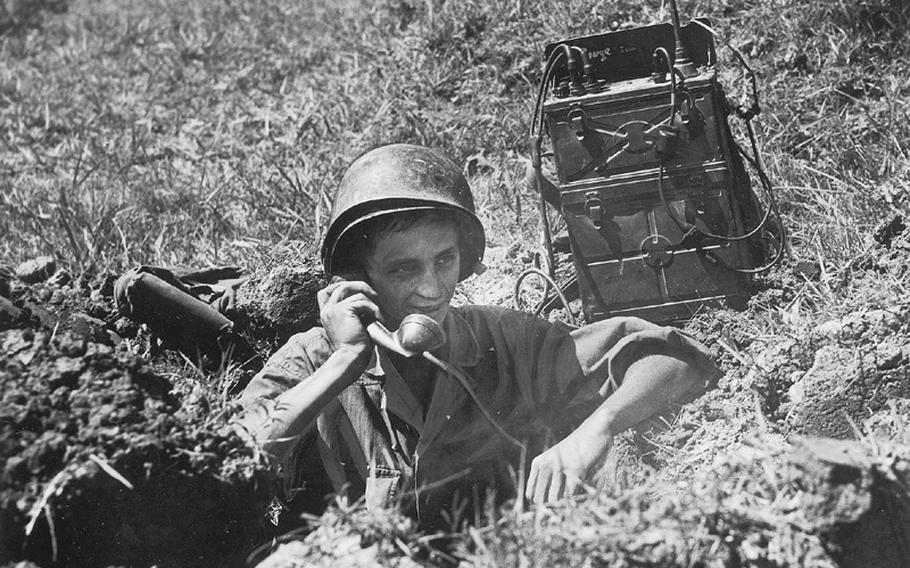 An American soldier manintains communication at a optar position on the fornt lines somewhere in Korea in this photo from July 25, 1950.