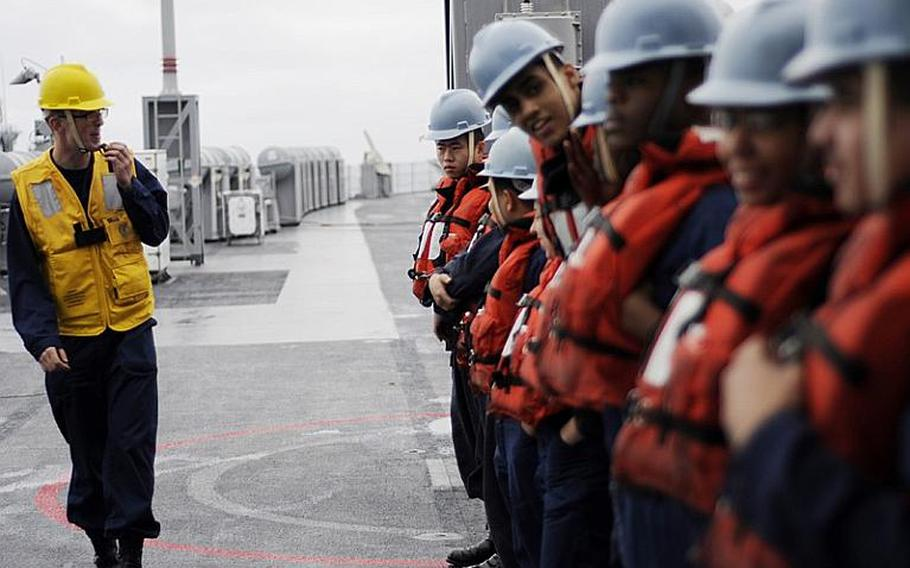 Petty Officer 2nd Class Andrew Raum briefs line handlers before a replenishment-at-sea aboard 7th Fleet command ship USS Blue Ridge on Monday. Blue Ridge transferred pallets of humanitarian assistance and disaster relief supplies to support Operation Tomodachi relief efforts in Japan.