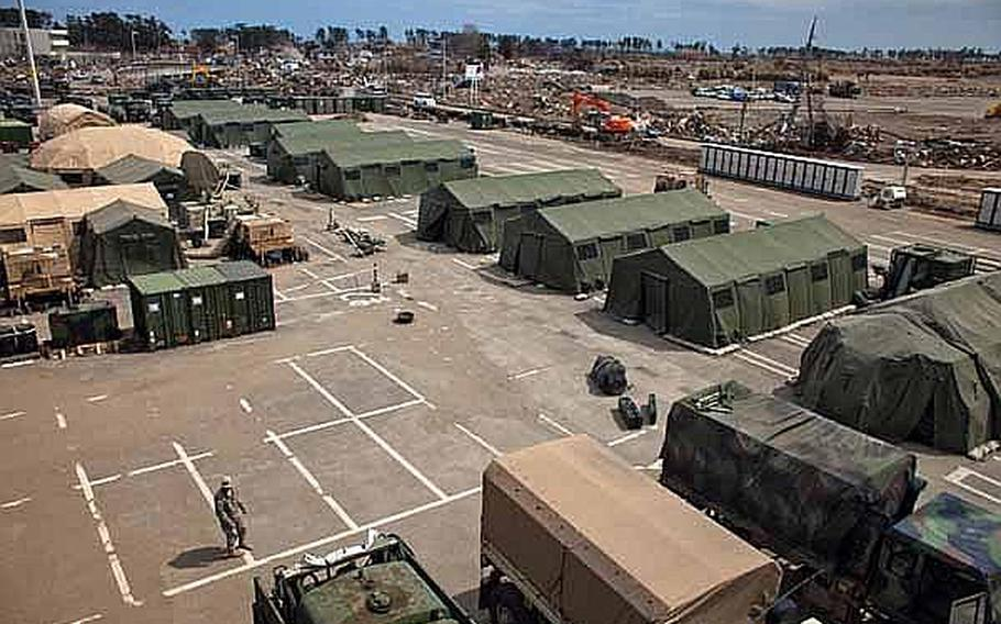 An elevated view of the temporary U.S. military camp set up at the Sendai Airport in Sendai, Japan, that is housing about 200 Marines and soldiers.