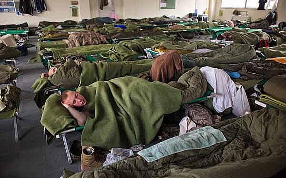 Marines, soldiers and troops from the Japan Self-Defense Force sleep in a male berthing at Camp Sendai, Japan.