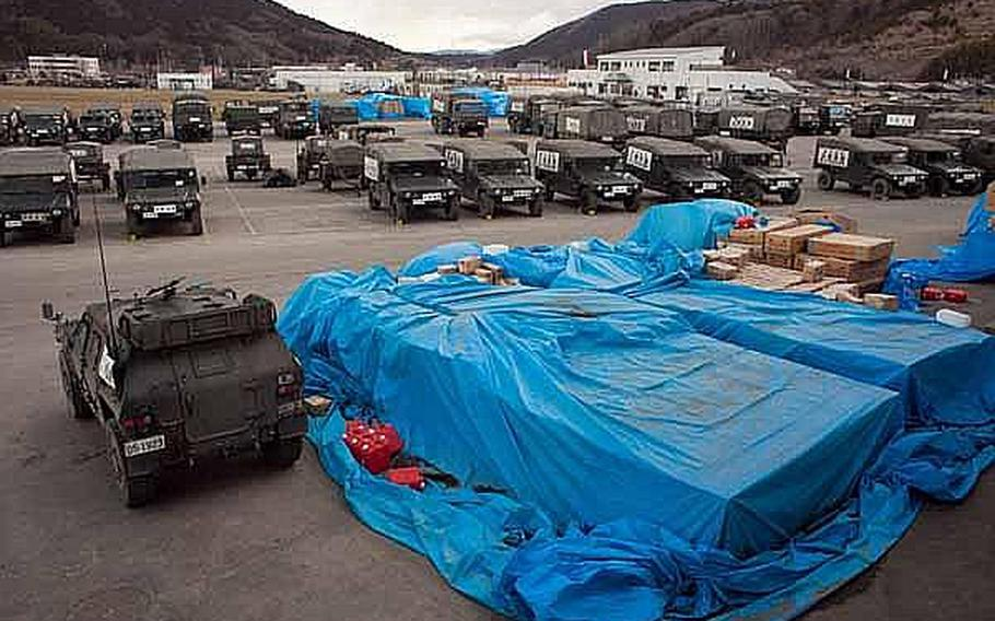 Japan Self-Defense Force vehicles and tents have taken over the Ishinomaki General Sports Park in Ishinomaki, Japan, which has become their base of operations for the area.