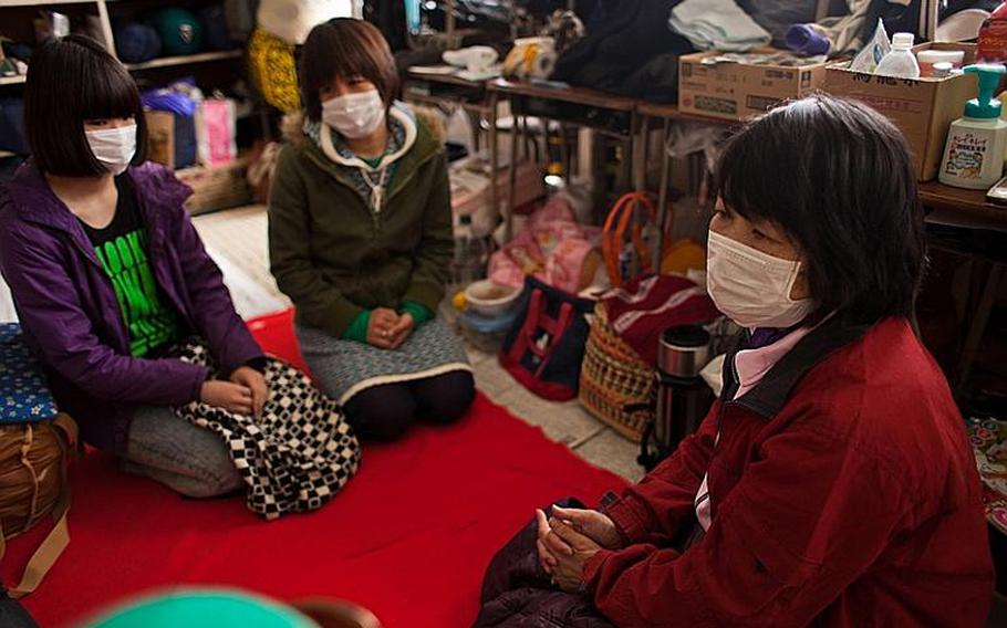 Yumi Nakajima, right, whose home was destroyed in the March 11 tsunami, sits with her sister and niece at the Kadonowaki Middle School shelter in Ishinomaki, Japan. Shelter officials have told its residents to clear out of the classrooms where they live by the beginning of the new school year on April 21.