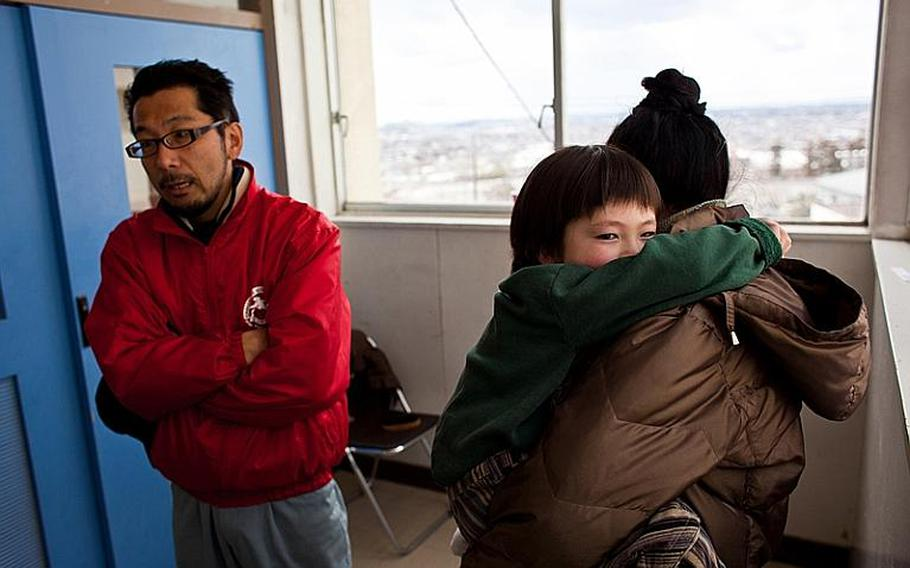 Takeshi Nakagawa, along with his wife, Chikako, and son Sota describe how they survived the March 11 tsunami that destroyed the first floor of their apartment. Nakagawa works for the family sweet-bean pastry business, but its area warehouse was destroyed in the tsunami.