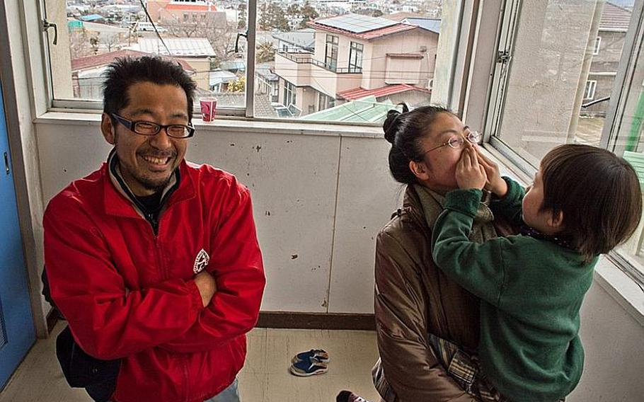 Takeshi Nakagawa, along with his wife, Chikako, and son Sota describe how they survived the March 11 tsunami. They are now staying at the Kadonowaki Middle School in Ishinomaki, Japan. The shelter said all displaced residents staying in the school's classrooms must clear out by the beginning of the new school year on April 21.