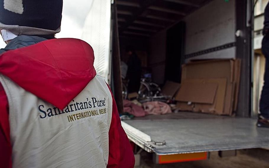 The back of a truck sits mostly empty after Marines from Okinawa and Camp Fuji assisted in the delivery of aid provided by the Christian relief organization Samaritan's Purse to the displaced residents of the Watanoha Elementary School shelter in Ishinomaki, Japan. The U.S. military has been coordinating with other NGOs to deliver aid, officials said.