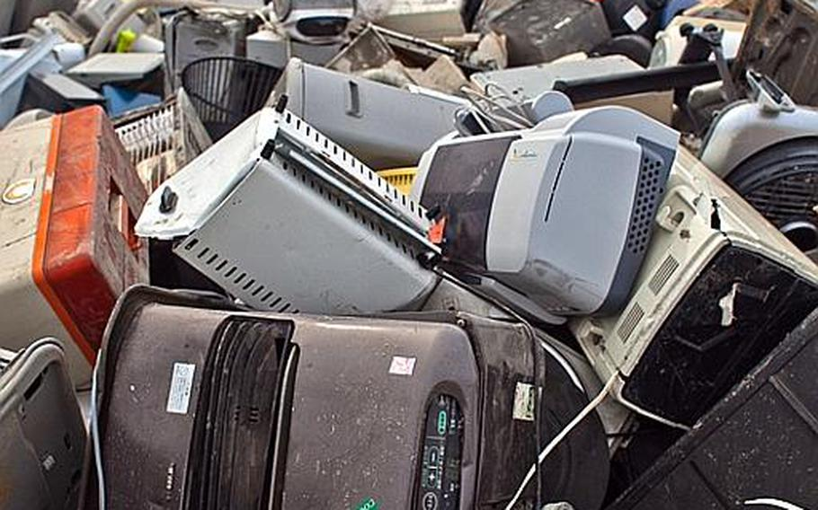 A pile of thousands of destroyed electrical appliances sit at one of two tsunami-related trash dump sites in Ishinomaki, Japan.