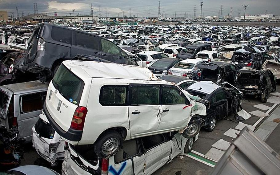 Destroyed cars pile up at a lot near Sendai Port. Temporary sites have been set up across the eastern coast to temporarily store tsunami-related trash.