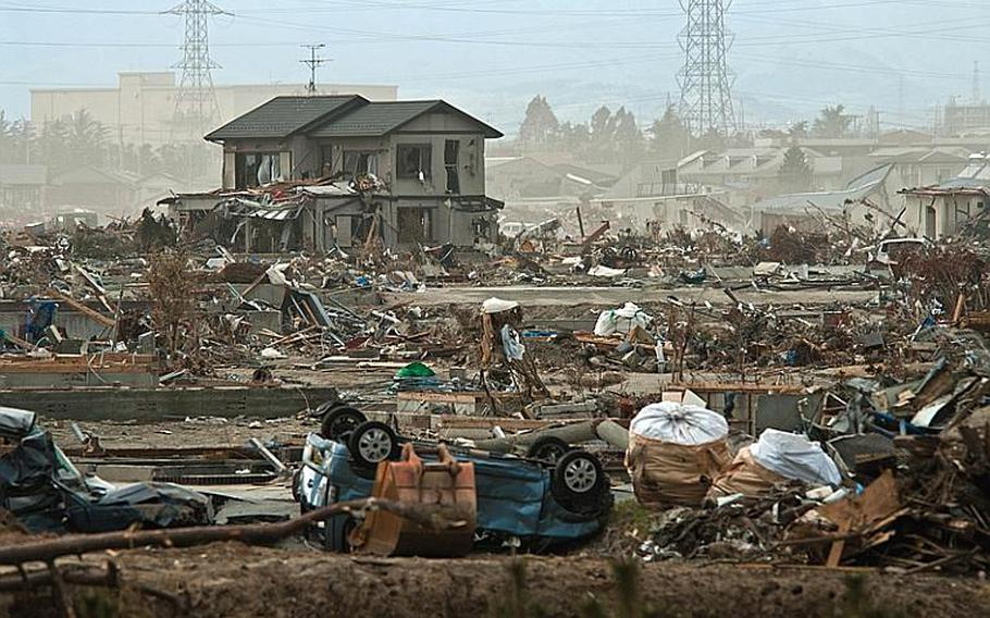 More wreckage waits to be cleared at the tsunami devestaed Nagahama Beach area of Sendai.