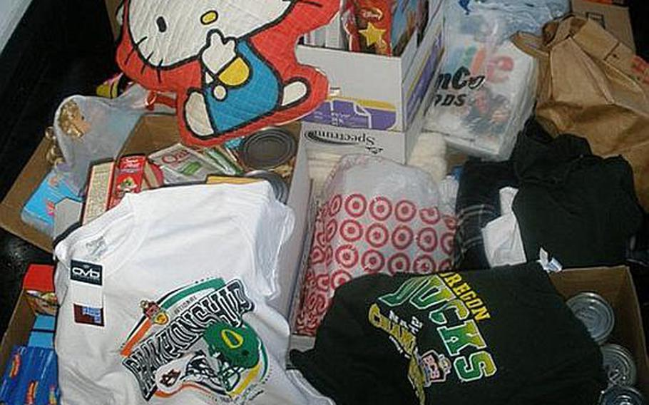 A pile of donations sits at the Toyota of Puyallup dealership on April 11. Seattle-area residents have donated about 200,000 pounds of supplies for orphans in northeastern Japan.