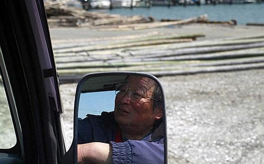 Fisherman Satoshi Nishimura, 63, who lost his boat in the tsunami, looks out over a harbor in Matsushima, Japan.