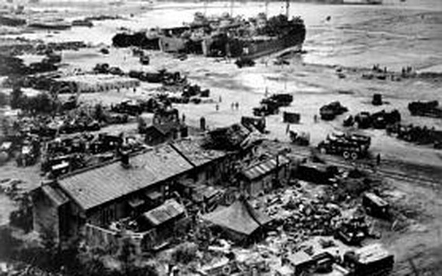 LST'S unloading at Wolmi-do, Inchon, Korea on D-plus and Marine trucks taking supplies to advancing troops.