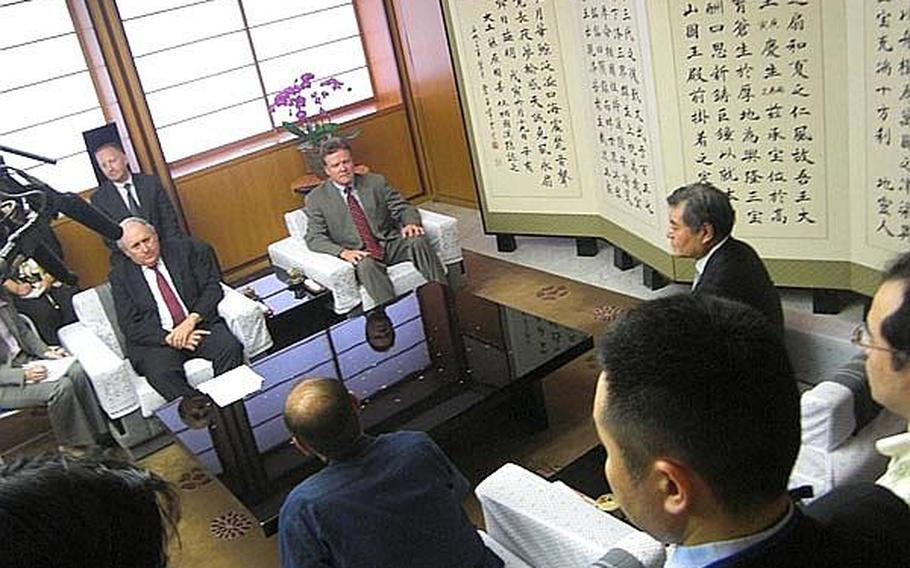 Sen. Carl Levin, D-Mich, left, and Sen. Jim Webb, D-Va., right, speak with Okinawa Gov. Hirokazu Nakaima, bottom center, during a meeting in Naha Wednesday about the Futenma air station relocation.