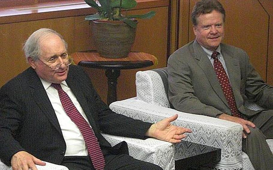 Sen. Carl Levin, D-Mich, left, and Sen. Jim Webb, D-Va., right, speak with Okinawa Gov. Hirokazu Nakaima during a meeting in Naha Wednesday about the Futenma air station relocation.