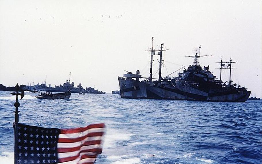 The vessel in the foreground on the right is the command ship of U.S. landing forces during the Battle of Okinawa in 1945.