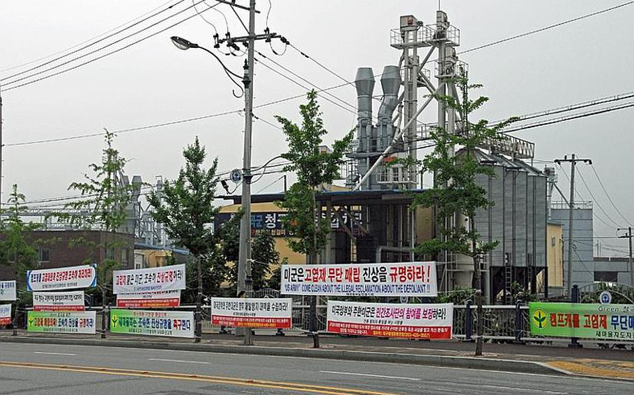 Approximately three dozen signs criticizing the U.S. hang across the street from the main entrance of Camp Carroll. The signs, posted by activist groups and a farmer's cooperative, demand that the U.S. government and U.S. military quickly investigate and apologize for its alleged burial of Agent Orange at the base in the late 1970s, conduct environmental surveys at all U.S. bases in South Korea, and provide compensation for environmental damage.