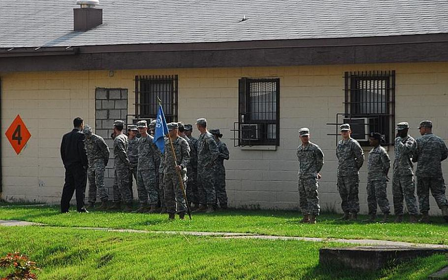 Soldiers at Camp Carroll stand at parade rest on a recent afternoon. The small Waegwon base has been at the center of a growing controversy since last month, when three former soldiers said last month that they helped bury Agent Orange near the base's helipad in 1978.