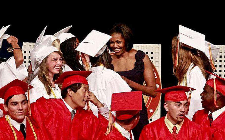 First lady Michelle Obama chats with the 2011 graduates of Quantico Middle/High School on Marine Corps Base Quantico, Va., June 3, 2011. The first lady gave the commencement address to the 36 graduates, including nine from Japan who relocated after the earthquake and tsunami earlier this year.