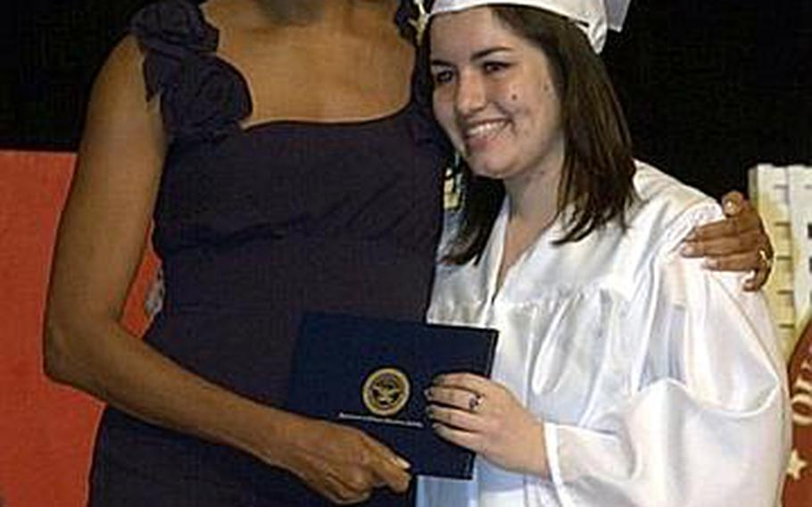 First lady Michelle Obama chats with a 2011 graduate of Quantico Middle/High School on Marine Corps Base Quantico, Va., June 3, 2011. The first lady gave the commencement address to the 36 graduates, including nine from Japan who relocated after the earthquake and tsunami earlier this year.