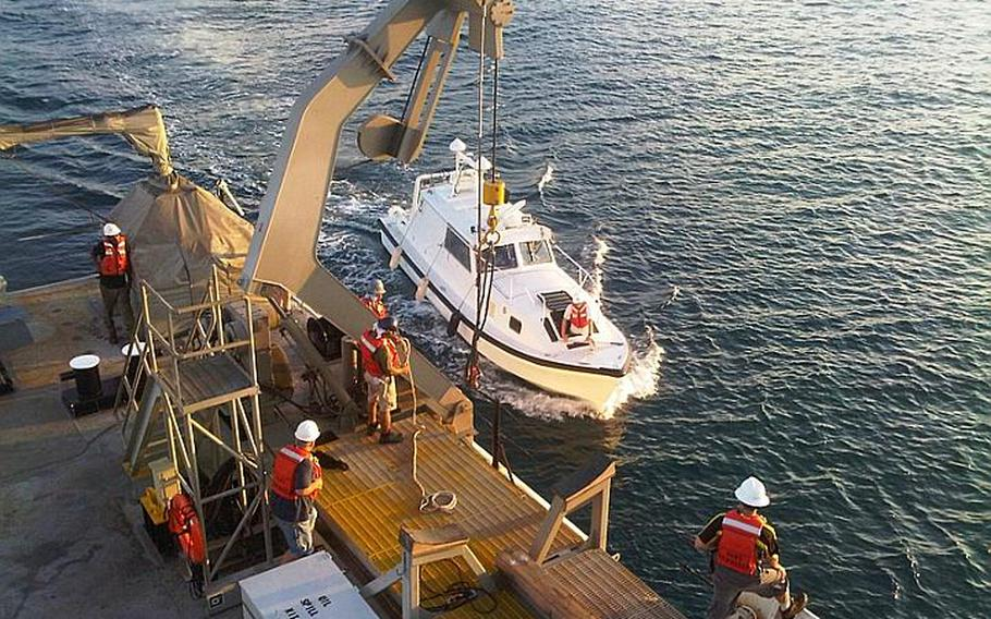 Crewmembers from the USNS Bowditch prepare a hydrographic survey launch during a recent mission off the coast of Vietnam to find underwater crash sites stemming from the Vietnam War. The U.S. Joint POW/MIA Accounting Command will use sonar data from the mission to search for the remains of fallen servicemembers.