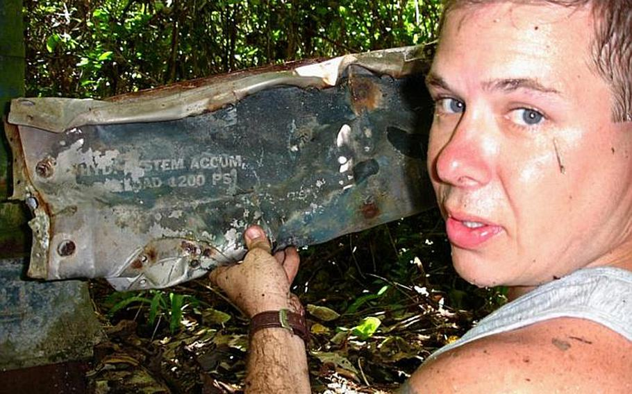 Pat Ranfranz  shows off a piece of wreckage from an old U.S. Navy FSF shipboard fighter plane he discovered on  Yap Island during his search in October of 2006 for the crash site of his uncle's long lost  B-24J bomber.