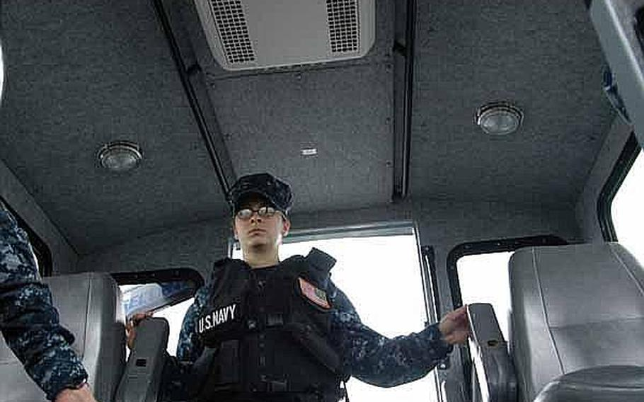 Seaman Apprentice Corrine Roberts remains vigilant while patrolling the harbor near Sasebo Naval Base, Japan, in mid-June.