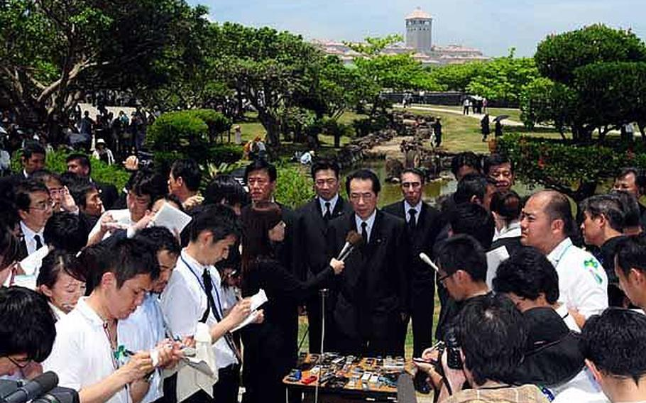 Prime Minister Naoto Kan talks to reporters after a memorial service held at Peace Prayer Park concluded, Thursday. The annual memorial ceremony takes place on June 23 to mark the anniversary of the end of the Battle of Okinawa.