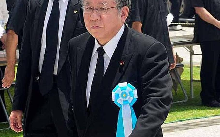 Takahiro Yokomichi, Speaker of the House of Representatives walks to his chair for the commencement of the Battle of Okinawa memorial service at Peace Prayer Park in Itoman.