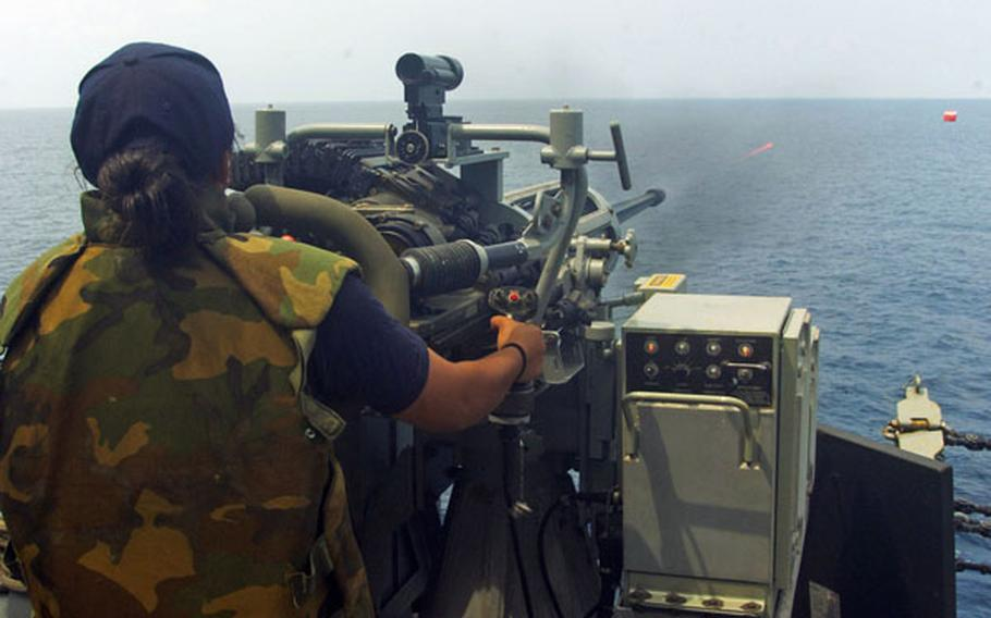 """Petty Officer 3rd Class Yuritsie Aguilar-Arenas fires upon a """"killer tomato"""" target aboard USS Howard during an exercise with Malaysia in the South China Sea on June 13. Recent incidents between Chinese vessels and other nations in the sea, which China claims most of as its sovereign territory, have led Southeast Asian nations to seek closer ties with the U.S. Navy."""