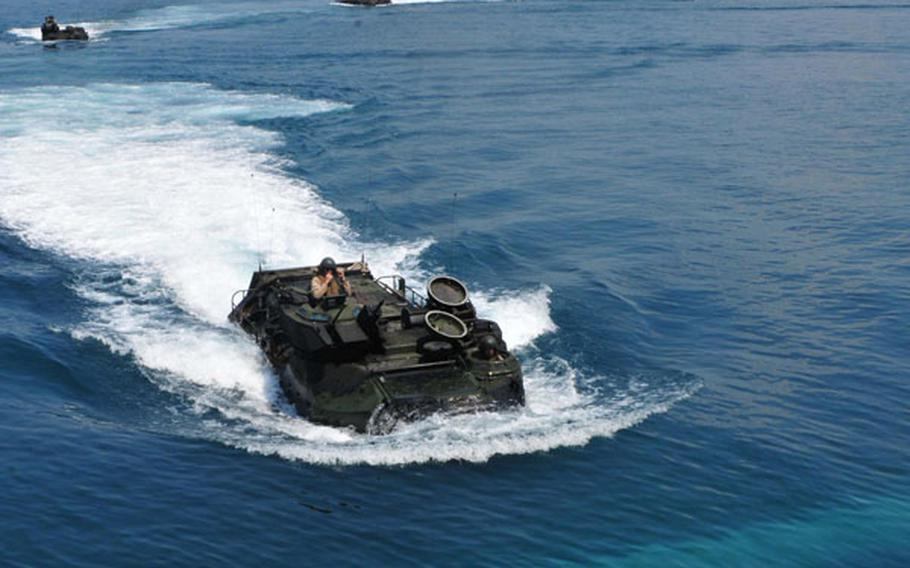 Amphibious assault vehicles approach the well deck of the USS Tortuga during an exercise with Malaysia in the South China Sea on June 12. Recent incidents between Chinese vessels and other nations in the sea, which China claims most of as its sovereign territory, have led Southeast Asian nations to seek closer ties with the U.S. Navy.