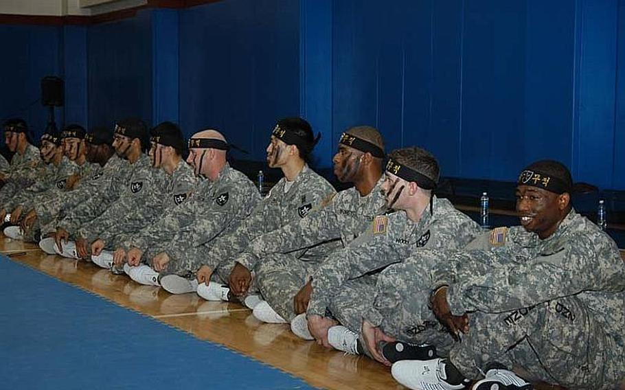 Members of the 2nd Infantry Division's Tae Kwon Do Demonstration Team wait their turn during a performance Aug. 3, 2011, at Camp Red Cloud in South Korea.