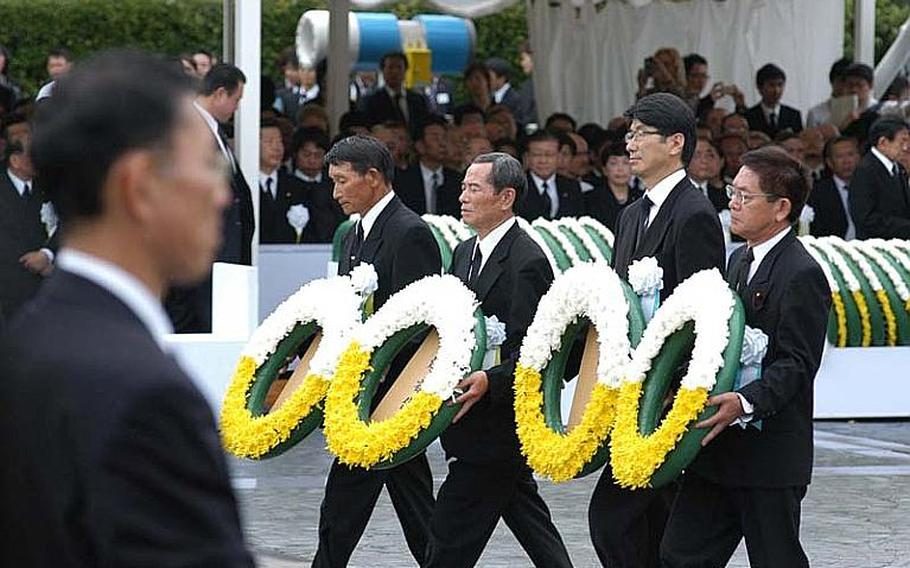 Nagasaki city officials lay wreaths for the victims of the atomic bomb 66 years ago.