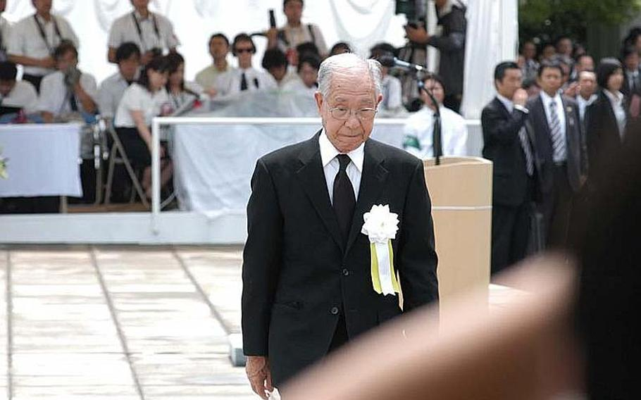 Atomic bomb survivor Hisao Matsuo makes his way from the podium after sharing his tale of survival and loss at the age of 17 on Aug. 9, 1945.