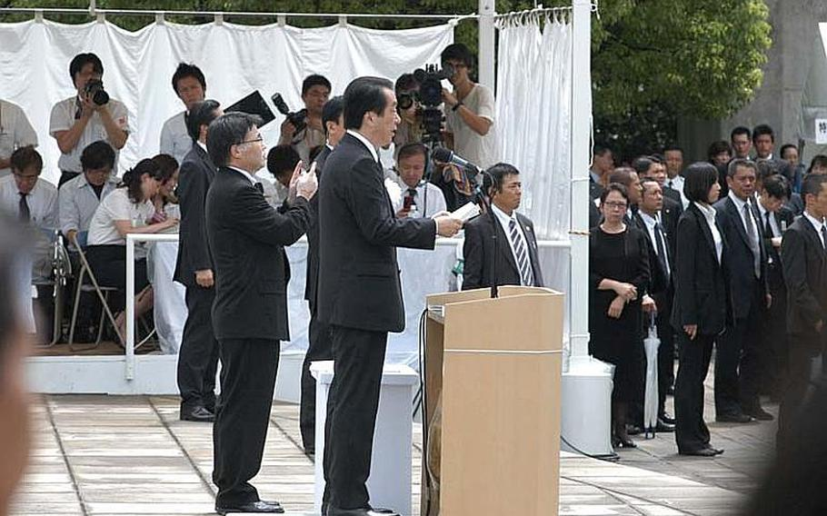 Japanese Prime Minister Naoto Kan addresses the audience during Tuesday's ceremony. The Prime Minister called for the abolition of nuclear weapons and to switching to renewable sources of power to end Japan's reliance on nuclear power in the wake of the March 11 earthquake and tsunami.