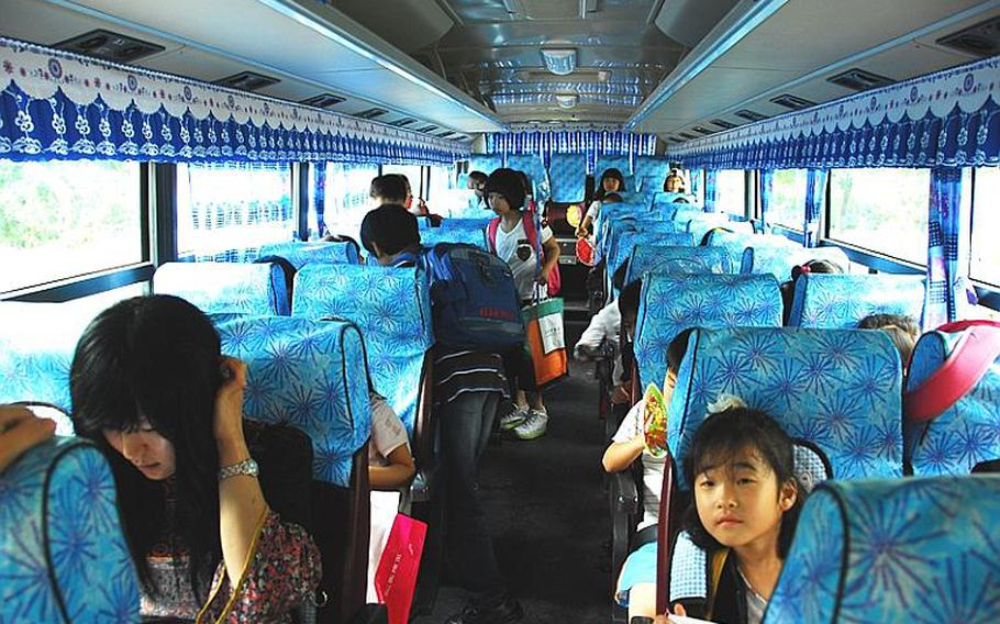 Commuter students, accompanied by teachers, board a bus that will take them out of Taesongdong at the end of the school day. Most Taesongdong students live in the nearby cities of Munsan and Paju, not in the village itself.
