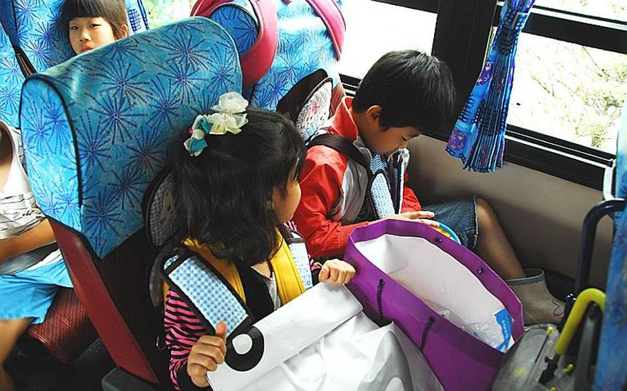 Taesongdong students wait on a school bus to leave the village at the end of the day. Most Taesongdong students live outside the village in neighboring Paju or Munsan.