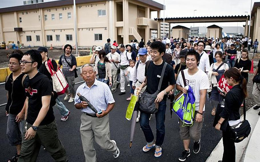 Massive crowds filed through the supply gate at Yokota Air Base, Japan, on Aug. 20, 2011, for the base's annual Japanese-American Friendship Festival. The two-day event was expected to draw more than 100,000 visitors, according to Yokota officials.