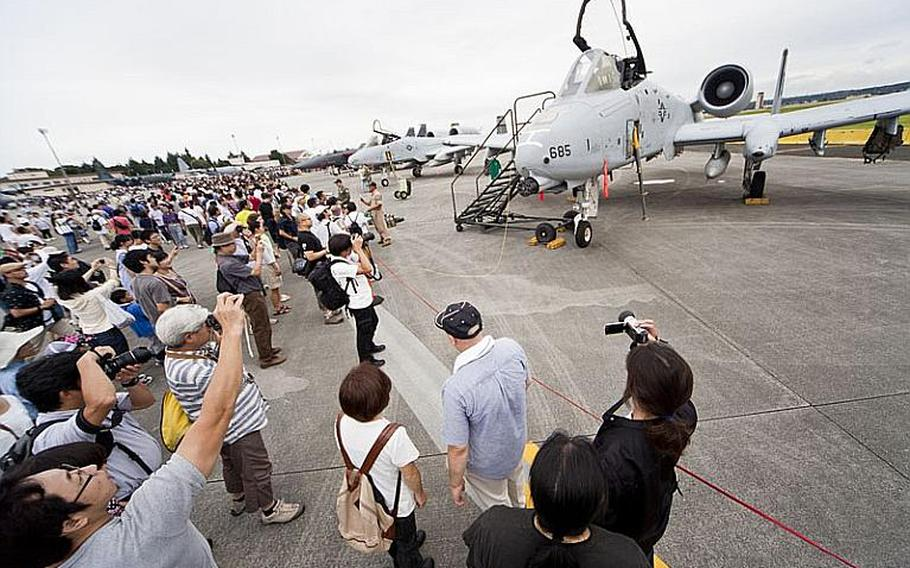Visitors gather to take photos in front of the A-10 Thunderbolt, one of the many aircraft on display Aug. 20, 2011, for the annual Japanese-American Friendship Festival at Yokota Air Base, Japan.