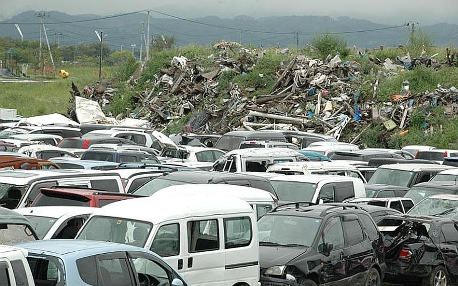 Piles of twisted metal and a field full of wrecked cars still greet people arriving at Sendai Airport but the camp that was home to soldiers and Marines and the stench from massive piles of rotting debris are long gone.