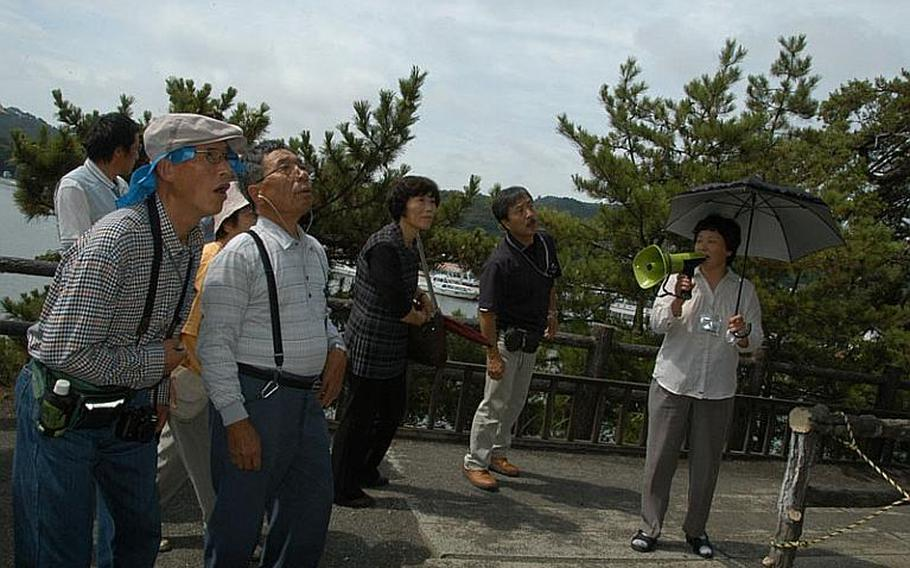 Tourists check out a historic shrine in Matsushima, Japan, on Aug. 24, 2011.