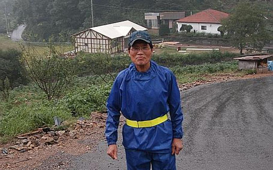 Kim Jong-whan, 72, walks up the road that snakes through Golsandong in South Korea and connects the 50 homes there. Kim has lived in the village since it was moved to a valley east of Camp Casey 60 years ago and says residents have benefitted from Golsandong's relationship with the adjacent U.S. base.