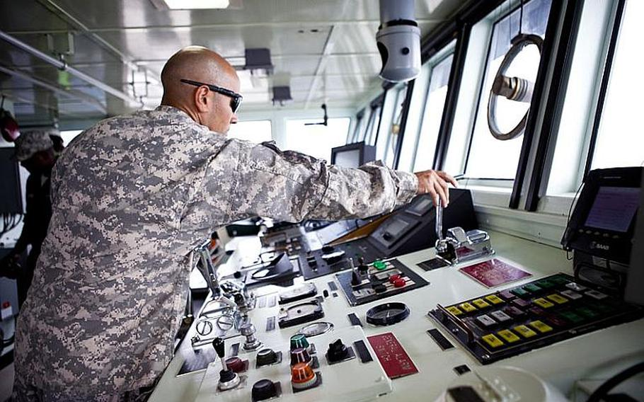Chief Warrant Officer 2  Matthew Jones, from the 97th Transportation Co. in Fort Eustis, Va., tests the Army's Land Craft Utility 2000 seaworthiness at Yokohama North Dock on Wednesday as part of the annual Pacific Reach excercise.