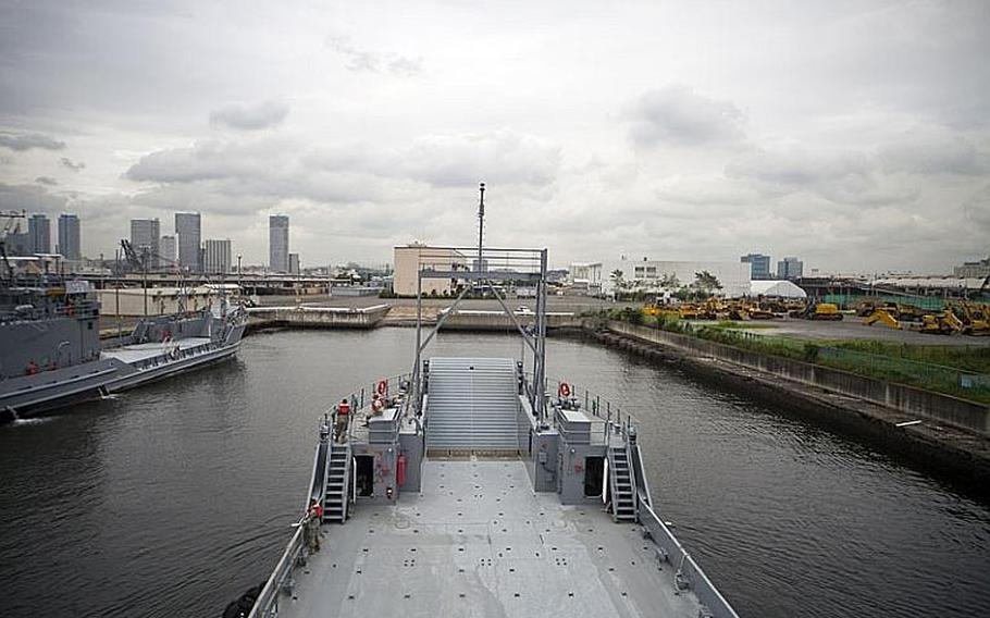 """The U.S. Army Land Craft Utility 2000 watercraft """"Broad Run"""" returns to Yokohama North Dock, where soldiers tested its seaworthiness Wednesday as part of the Army's annual Pacific Reach excercise."""
