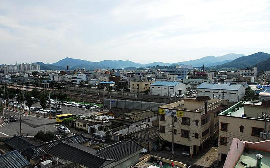 The South Korean government began a health survey this week that could include as many as 6,500 residents of Waegwan - whose skyline is pictured here - near Camp Carroll. Some U.S. veterans claim they buried Agent Orange at the military base in 1978. Residents and local officials fear the chemicals may have caused illnesses.