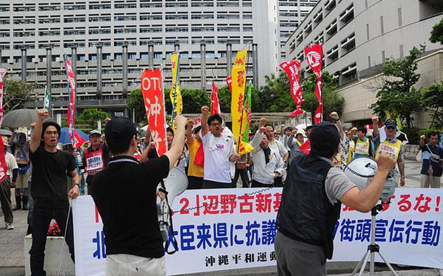 Approximately 150 protesters demonstrate outside the Prefectural Government Office in Naha, Okinawa, in this May file photo. Despite such protests, which have become commonplace on the island, Japan's new government says it intends to move forward with plans to relocate Marine Corps air operations from Futenma to Camp Schwab.