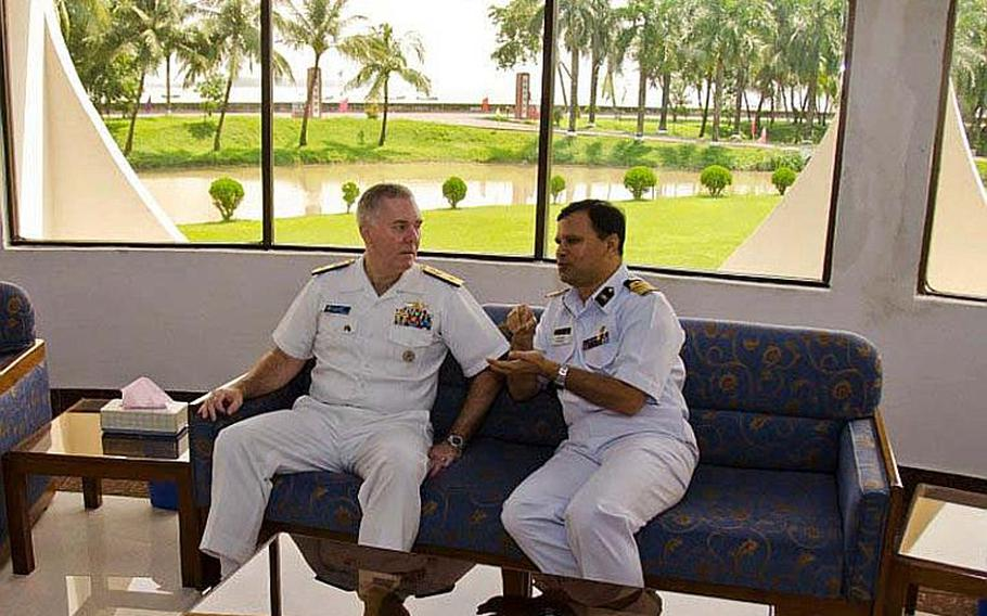 Rear Adm. Tom Carney, commander of Task Force 73, left, meets with Capt. Aslam Parvez of the Bangladesh Navy during Cooperation Afloat Readiness and Training (CARAT) Bangladesh 2011. CARAT is a series of bilateral exercises held annually in Southeast Asia to strengthen relationships and enhance force readiness, and Bangladesh is taking part in this exercise for the first time.