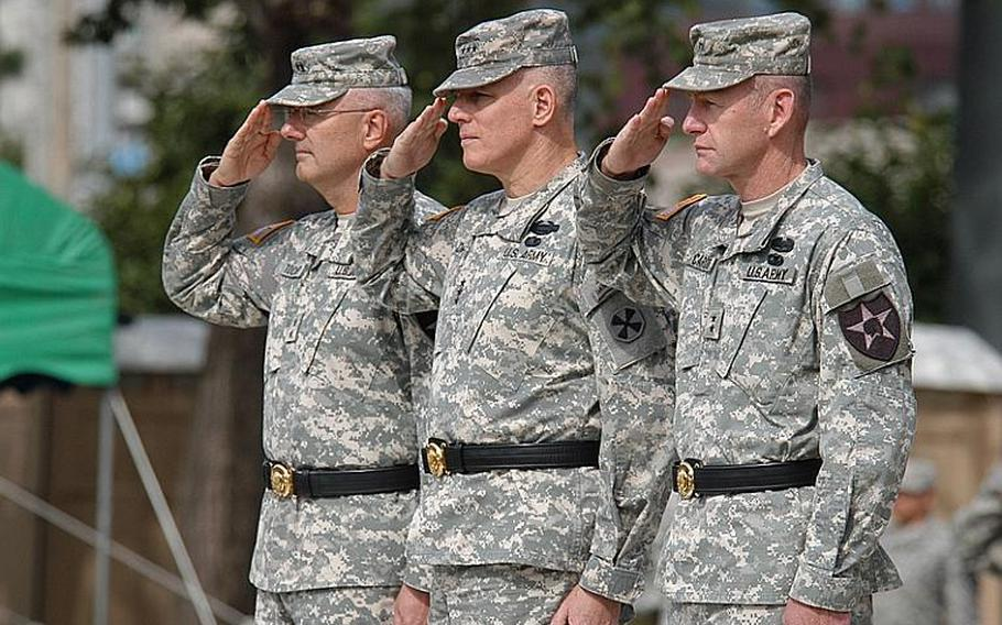 Maj. Gen. Michael Tucker, left, 8th Army commander Lt. Gen. John Johnson, center, and Maj. Gen. Edward Cardon, right, salute during the 2nd Infantry Division's change of command ceremony Tuesday at Camp Casey in South Korea. Cardon succeeded Tucker as commander of the division, most of which is stationed in the northernmost U.S. bases in South Korea.