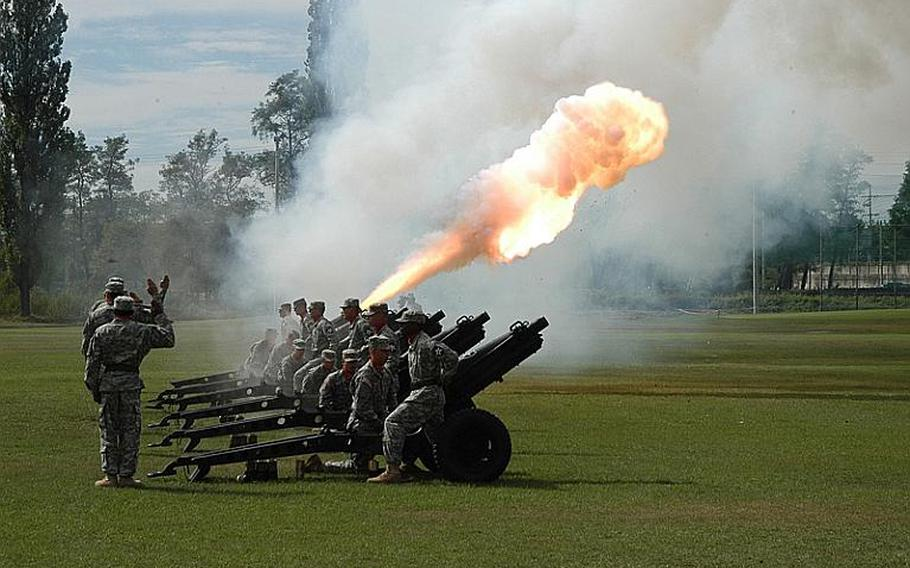 A cannon is fired during the 2nd Infantry Division's change of command ceremony Tuesday at Camp Casey in South Korea. Maj. Gen. Edward Cardon assumed command at the ceremony, succeeding Maj. Gen. Michael Tucker.