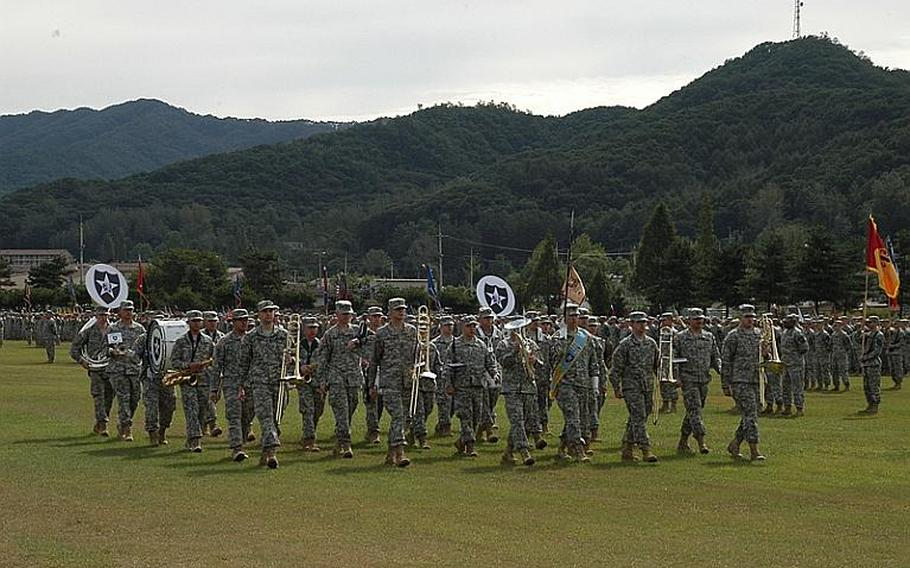 The 2nd Infantry Division Band marches during a change of command ceremony Tuesday at Camp Casey in South Korea. Maj. Gen. Edward Cardon succeeded Maj. Gen. Michael Tucker as commander of the division.