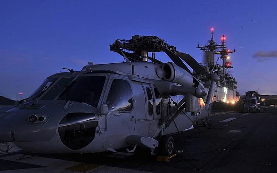 Several MH-60S Sea Hawks from Helicopter Sea Combat Squadron 25 sit on the flight deck of the forward deployed amphibious assault ship USS Essex Thursday at Sasebo Naval Base. The Essex is currently underway for a patrol of the western Pacific.